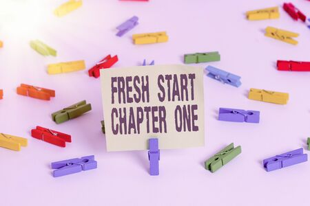 Word writing text Fresh Start Chapter One. Business photo showcasing changes in your circumstances new career and chances Colored clothespin papers empty reminder white floor background office