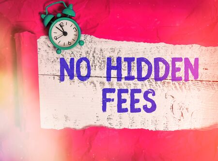 Word writing text No Hidden Fees. Business photo showcasing without or zero bank charge, service charge, or extras Rolled ripped torn cardboard placed above a wooden classic table backdrop Фото со стока