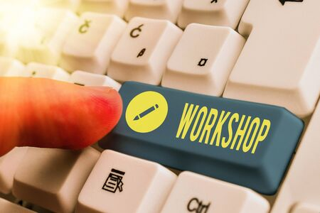 Writing note showing Workshop. Business concept for space or a building where the goods are produced or repaired White pc keyboard with empty note paper above white key copy space