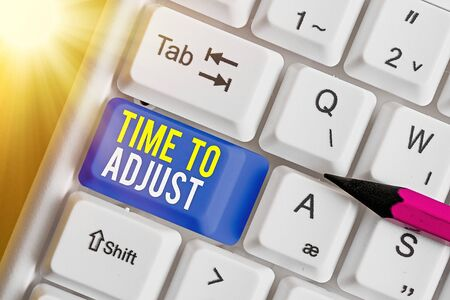 Text sign showing Time To Adjust. Business photo text making necessary or desirable changes to corresponding White pc keyboard with empty note paper above white key copy space