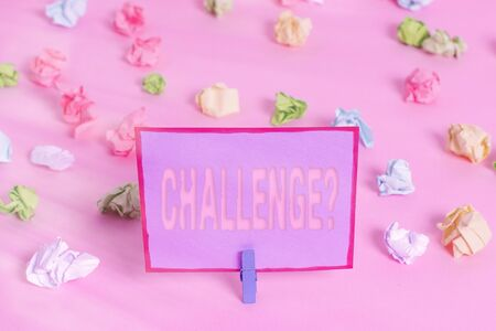 Writing note showing Challenge Question. Business concept for Invitation to engage in a race in particular duel Colored crumpled papers empty reminder pink floor background clothespin Stock Photo