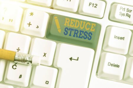 Conceptual hand writing showing Reduce Stress. Concept meaning to lessen the state of mental or emotional strain or tension White pc keyboard with empty note paper above white key copy space