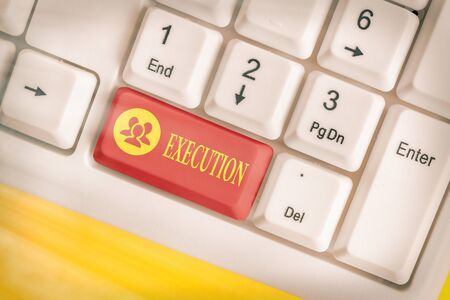Word writing text Execution. Business photo showcasing it executes or imposes a program order or course of action White pc keyboard with empty note paper above white key copy space 스톡 콘텐츠