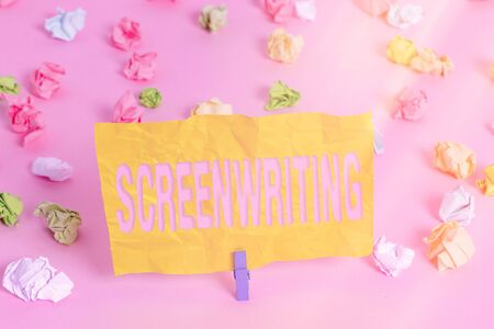Handwriting text writing Screenwriting. Conceptual photo the art and craft of writing scripts for media communication Colored crumpled papers empty reminder pink floor background clothespin Stok Fotoğraf