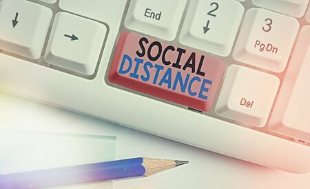 Handwriting text writing Social Distance. Conceptual photo degree of acceptance of general interaction of individuals White pc keyboard with empty note paper above white key copy space