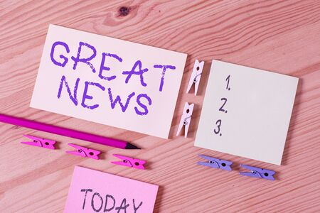 Word writing text Great News. Business photo showcasing the surprised reaction of learning good news or fortunate event Colored clothespin papers empty reminder wooden floor background office
