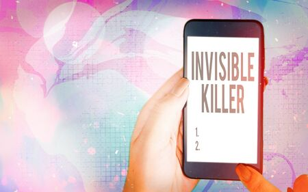 Word writing text Invisible Killer. Business photo showcasing presence into the air of a substance which are harmful Modern gadgets with white display screen under colorful bokeh background