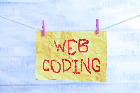 Word writing text Web Coding. Business photo showcasing a system of symbols and rules used to represent instructions Clothesline clothespin rectangle shaped paper reminder white wood desk