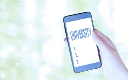 Handwriting text writing University. Conceptual photo an educational institution designed to teach and investigate Modern gadgets with white display screen under colorful bokeh background