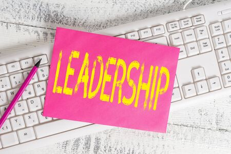 Handwriting text writing Leadership. Conceptual photo art of motivating to act toward achieving a common goal White keyboard office supplies empty rectangle shaped paper reminder wood Foto de archivo