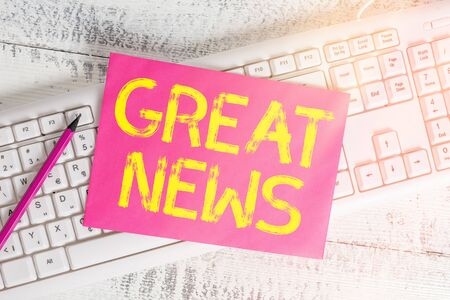 Handwriting text writing Great News. Conceptual photo the surprised reaction of learning good news or fortunate event White keyboard office supplies empty rectangle shaped paper reminder wood