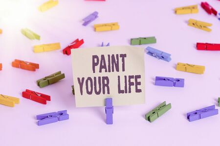 Word writing text Paint Your Life. Business photo showcasing Taking control and create your future to achieve goals Colored clothespin papers empty reminder white floor background office