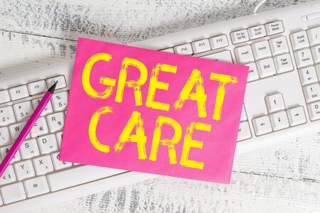 Handwriting text writing Great Care. Conceptual photo giving attention, consideration, love, and comfort towards others White keyboard office supplies empty rectangle shaped paper reminder wood Zdjęcie Seryjne