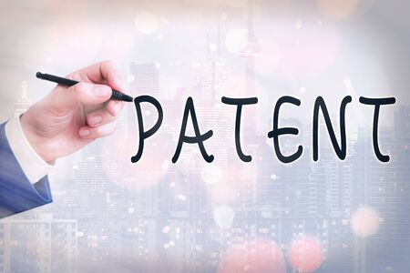 Conceptual hand writing showing Patent. Concept meaning intellectualproperty that gives owner legal right has the sole right Touch screen digital marking important details in business