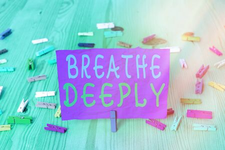 Handwriting text writing Breathe Deeply. Conceptual photo to take a lot of air into the lungs inhaleexhale fully Colored crumpled rectangle shaped reminder paper light blue background