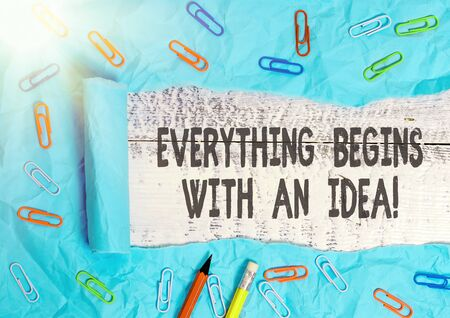 Handwriting text writing Everything Begins With An Idea. Conceptual photo things can be a reality with actions to take Rolled ripped torn cardboard placed above a wooden classic table backdrop