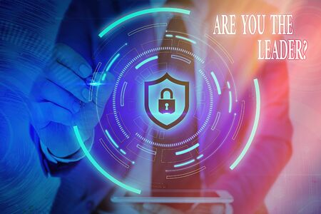 Writing note showing Are You The Leader Question. Business concept for asking for the qualification of being a good boss Graphics padlock for web data information security application system Standard-Bild
