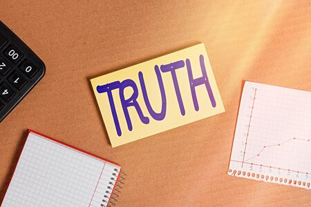 Word writing text Truth. Business photo showcasing used to mean being in accord with fact reality or fidelity to standard Cardboard paperboard notebook office study supplies chart reminder paper Foto de archivo