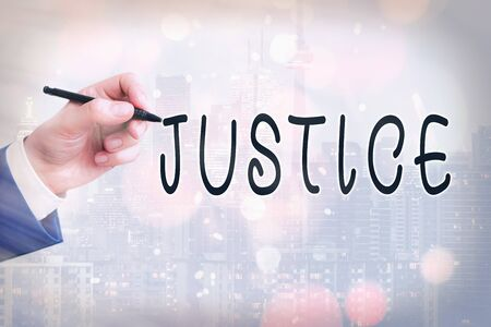 Conceptual hand writing showing Justice. Concept meaning use of power as appointed by law standards to support fair treatment Touch screen digital marking important details in business