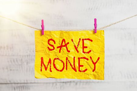 Word writing text Save Money. Business photo showcasing to budget or put money aside for the future or emergency Clothesline clothespin rectangle shaped paper reminder white wood desk