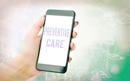 Conceptual hand writing showing Preventive Care. Concept meaning the care you receive to prevent illnesses or diseases Modern gadgets white screen under colorful bokeh background
