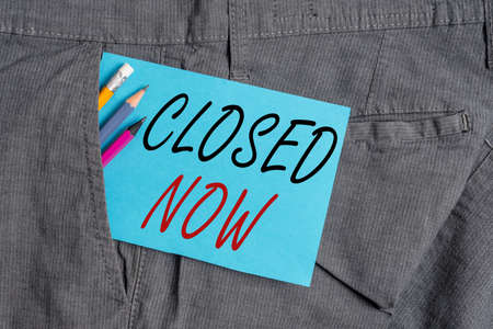 Handwriting text Closed Now. Conceptual photo of a business having ceased trading especially for a short period Writing equipment and blue note paper inside pocket of man work trousers