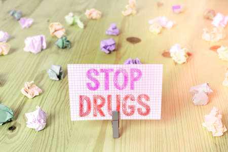 Writing note showing Stop Drugs. Business concept for put an end on the dependence on substances such as heroin or cocaine Colored crumpled rectangle shaped reminder paper light blue background