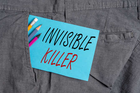 Handwriting text Invisible Killer. Conceptual photo presence into the air of a substance which are harmful Writing equipment and blue note paper inside pocket of man work trousers