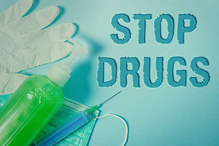 Conceptual hand writing showing Stop Drugs. Concept meaning put an end on the dependence on substances such as heroin or cocaine Primary medical precautionary equipments health protection