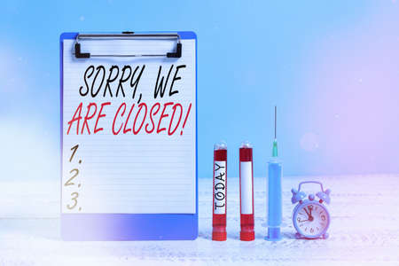 Text sign showing Sorry, We Are Closed. Business photo showcasing apologize for shutting off business for specific time Extracted blood sample vial with medical accessories ready for examination 版權商用圖片