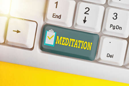 Writing note showing Meditation. Business concept for achieve a mentally clear and emotionally calm and stable state White pc keyboard with empty note paper above white key copy space