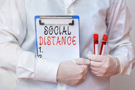 Conceptual hand writing showing Social Distance. Concept meaning degree of acceptance of general interaction of individuals Laboratory blood test sample for medical diagnostic analysis Standard-Bild