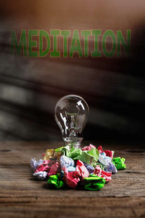 Text sign showing Meditation. Business photo showcasing achieve a mentally clear and emotionally calm and stable state Realistic colored vintage light bulbs, idea sign solution thinking concept