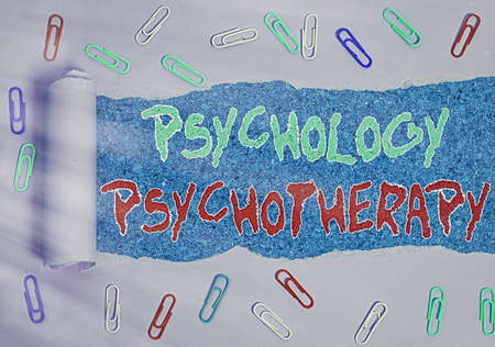Word writing text Psychology Psychotherapy. Business photo showcasing use of a psychological method to treat mental illness Rolled ripped torn cardboard placed above a wooden classic table backdrop