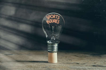 Handwriting text writing Sports Injuries. Conceptual photo injuries that occur when engaging in sports or exercise Realistic colored vintage light bulbs, idea sign solution thinking concept Reklamní fotografie