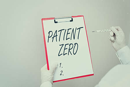 Writing note showing Patient Zero. Business concept for primary disease carrier of the highlycontagious disease Laboratory blood test sample for medical diagnostic analysis