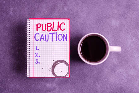 Text sign showing Public Caution. Business photo text formal warning given to the public to express a potential risk Paper accesories with digital smartphone arranged on different background