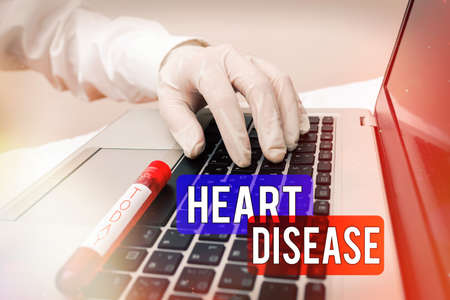 Handwriting text writing Heart Disease. Conceptual photo A type of disease that affects the heart or blood vessels Extracted blood sample vial with lastest technology ready for examination Reklamní fotografie