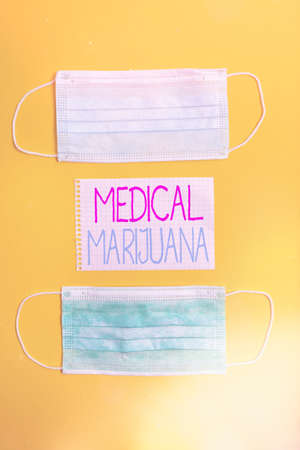 Conceptual hand writing showing Medical Marijuana. Concept meaning available only by prescription and used to treat illness Set of medical equipment with notepad for health assessment