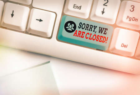 Handwriting text writing Sorry, We Are Closed. Conceptual photo apologize for shutting off business for specific time White pc keyboard with empty note paper above white key copy space
