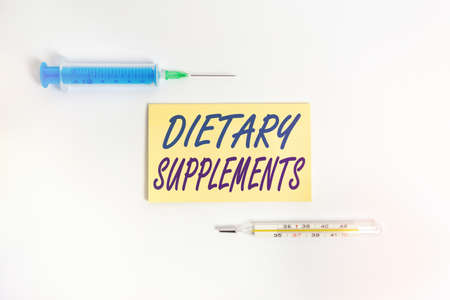 Text sign showing Dietary Supplements. Business photo showcasing product intended to supplement the diet taken orally Set of medical equipment with notepad for health condition assessment