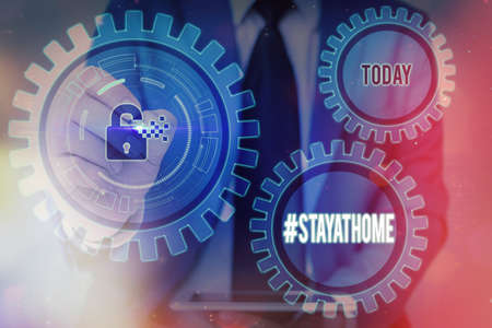 Writing note showing Hashtag Stay at home. Business concept for a trending label in social media related to the coronvirus outbreak Graphics padlock for web data information security application system