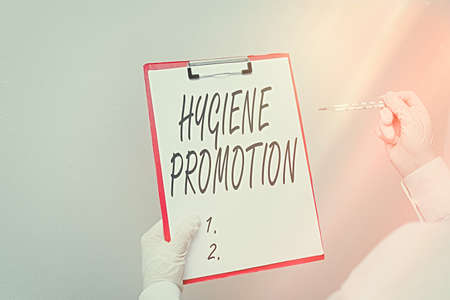 Writing note showing Hygiene Promotion. Business concept for systematic program to prevent related disease with sanitation Laboratory blood test sample for medical diagnostic analysis