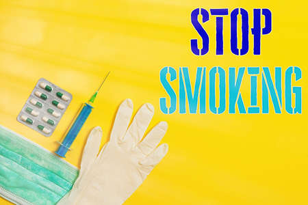 Word writing text Stop Smoking. Business photo showcasing the process of discontinuing or quitting tobacco smoking Primary medical precautionary equipments for health care protection Фото со стока