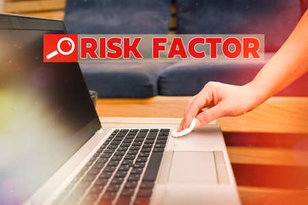Text sign showing Risk Factor. Business photo showcasing Characteristic that may increase the percentage of acquiring a disease Contamination within electronic gadgets sufaces controlled by disinfectant
