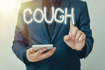 Writing note showing Cough. Business concept for sudden expulsion of air throughout the passages to clear airways Model with pointing hand finger symbolizing navigation progress growth Stok Fotoğraf
