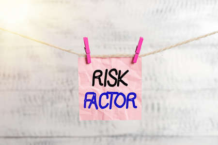 Conceptual hand writing showing Risk Factor. Concept meaning Characteristic that may increase the percentage of acquiring a disease Clothespin rectangle shaped paper reminder white wood desk Stok Fotoğraf