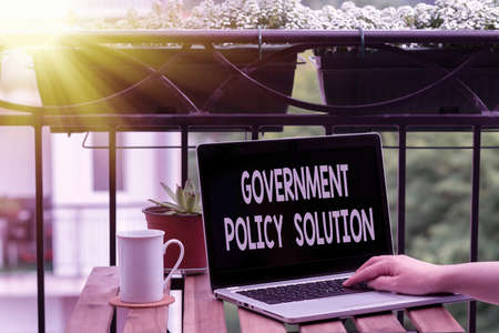 Handwriting text writing Government Policy Solution. Conceptual photo designed game plan created in response to emergency disaster Personal workplace overview with laptop device used for individual interest