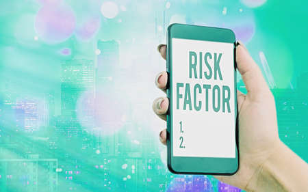 Writing note showing Risk Factor. Business concept for Characteristic that may increase the percentage of acquiring a disease Modern gadgets white screen under colorful bokeh background