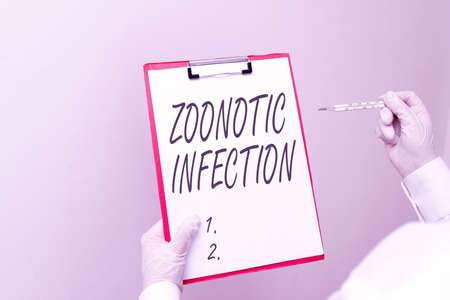Writing note showing Zoonotic Infection. Business concept for communicable disease transmitted by a non viral agent Laboratory blood test sample for medical diagnostic analysis